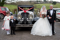 Bride, Father and children arriving in vintage car at Langdon Court, Nr Plymouth, Devon