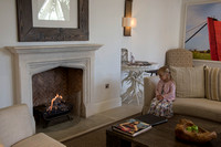 little girl sat in front of coal fire in reception at Salcombe Harbour Hotel, Salcombe, Devon