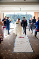 bride and groom walking up the aisle in ceremony room at Salcombe Harbour Hotel, Salcombe, Devon