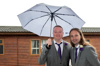 groom and best man under white umbrella at Whitsand Bay Fort, Cornwall