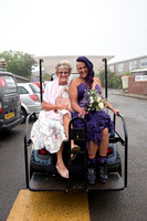 Bride and mother on golf cart travelling to ceremony room at Whitsand Bay Fort, Cornwall