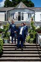 Groom, father and father in law walking down steps at Lavender House hotel, Ashburton, Devon