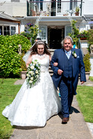 Bride and father walking down aisle outside at Lavender House hotel, Ashburton, Devon