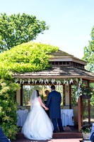 Back view of Bride and Groom under gazebo during ceremony at Lavender House hotel, Ashburton, Devon