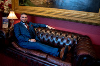 Groom sitting on leather settee at Bedford Hotel, Tavistock, Devon