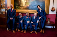 Groom and Groomsmen sitting on settee inside Bedford Hotel, Tavistock, Devon