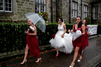 Bridal party walking on road outside Bedford Hotel, Tavistock, Devon