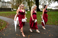 Bridal party walking outside St Eustatius Church Tavistock Devon