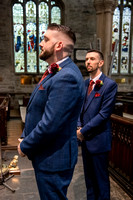 Groom waiting for bride inside St Eustatius Church Tavistock Devon