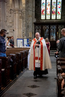 Minister walking down aisle at St Eustatius Church Tavistock Devon